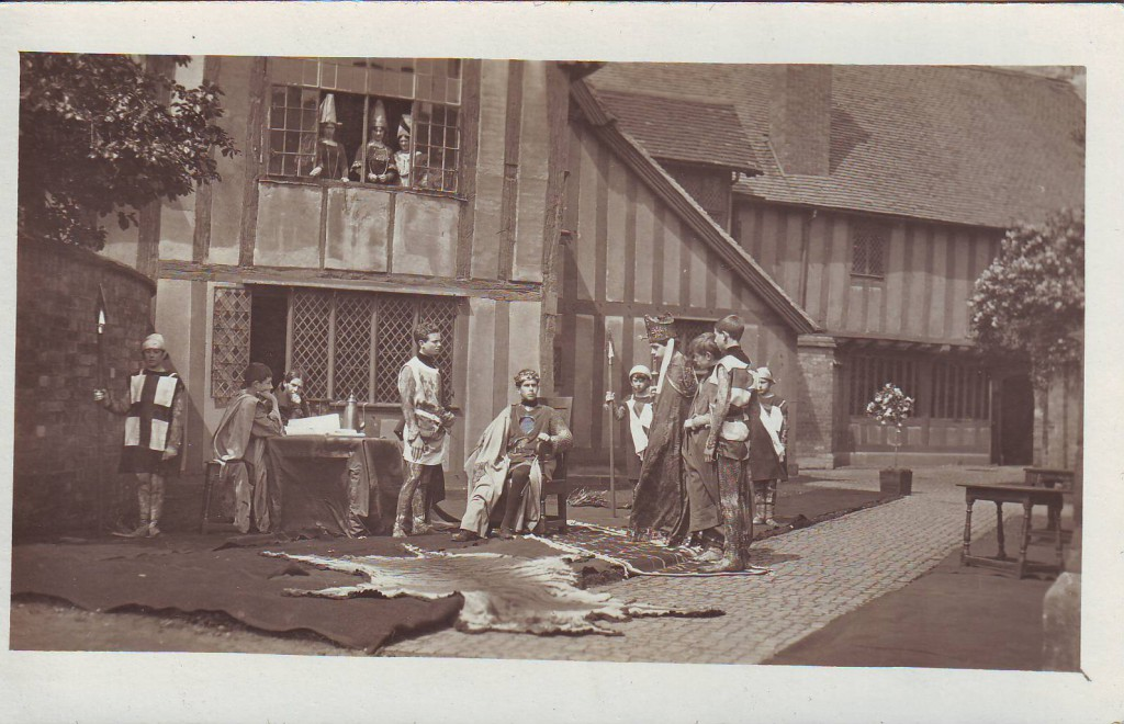 Herbert Jennings, standing centre by the table, as the Earl of Salisbury in Henry V, 1913
